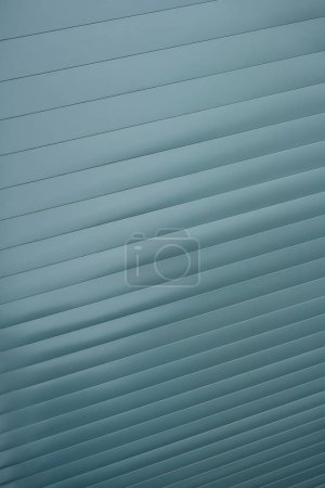 Striped diagonal grey texture, abstract background