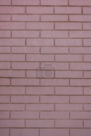 full frame view of pink brick wall textured background