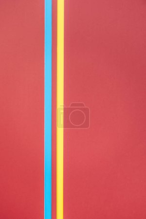 yellow and blue lines on red minimalistic background