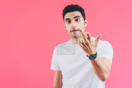 selective focus of irritated man showing middle finger isolated on pink
