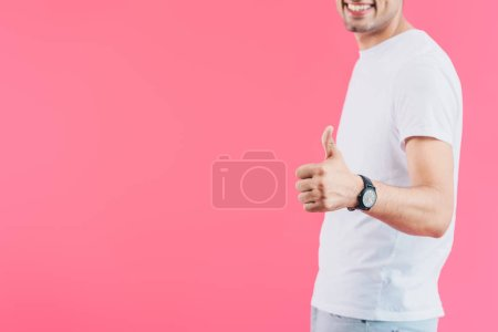 cropped image of smiling man showing thumb up isolated on pink
