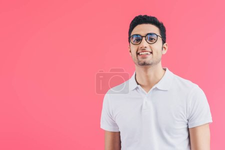 Photo for Smiling handsome man looking at camera isolated on pink - Royalty Free Image