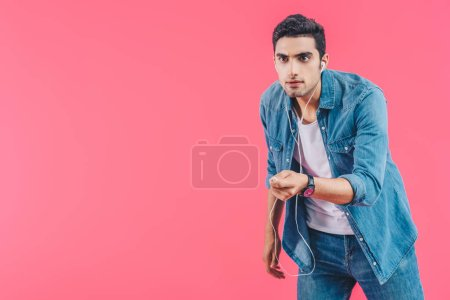 Photo for Portrait of young man in casual clothing and earphones isolated on pink - Royalty Free Image