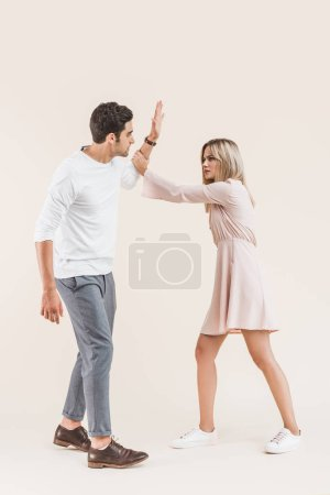 young couple quarreling isolated on beige, Relationship difficulties concept