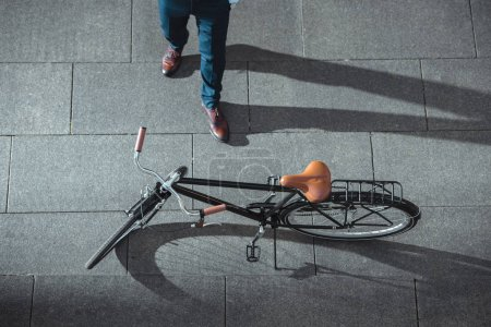 Photo for Partial top view of businessman and bicycle on street - Royalty Free Image