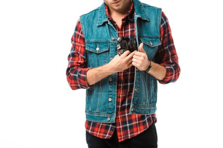 partial view of hipster male photographer in denim vest and checkered shirt holding camera isolated on white