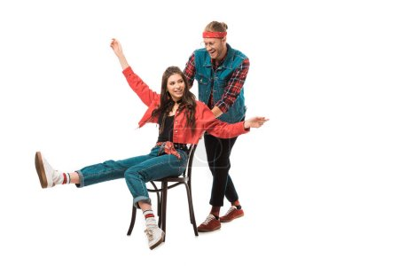 hipster girl with wide arms sitting on chair while her happy boyfriend standing behind isolated on white