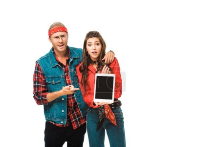hipster man pointing by finger at digital tablet with blank screen while his girlfriend standing near isolated on white