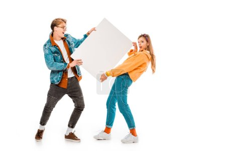 cheerful hipster couple holding empty banner isolated on white