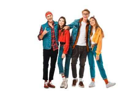 male hipster man in denim vest showing rock gesture while his friends standing near isolated on white