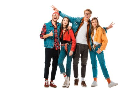 happy hipster men showing peace signs and thumb up while their female friends standing near isolated on white