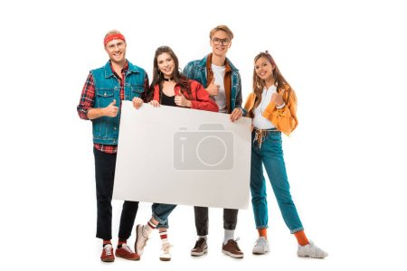 stylish hipster friends showing thumbs up and holding blank banner isolated on white