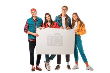 cheerful stylish hipster friends holding blank banner isolated on white