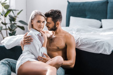 passionate sexy couple cuddling in bedroom