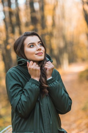 Photo for Selective focus of beautiful young woman in jacket posing outdoors - Royalty Free Image