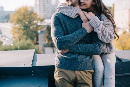 Photo for Cropped shot of young couple embracing on rooftop - Royalty Free Image