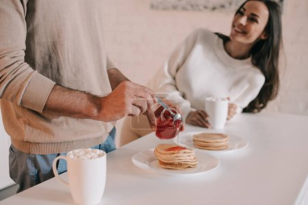 Photo for Cropped shot of young couple with pancakes for breakfast at home - Royalty Free Image
