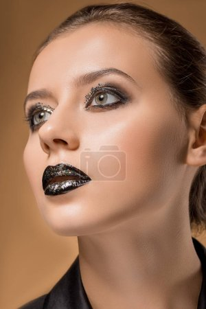 close up of young beautiful woman with glittery makeup