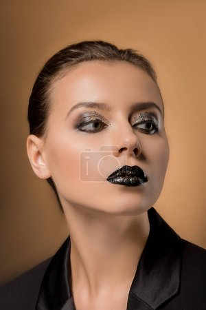young beautiful woman with glittery makeup