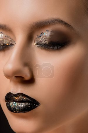 close up of young beautiful woman with glittery makeup and closed eyes