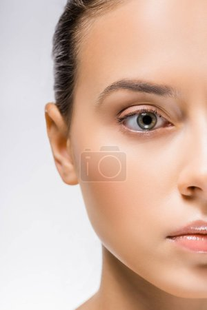 cropped face of young beautiful woman with nude makeup