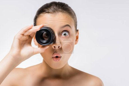 young woman with funny face expression and lens