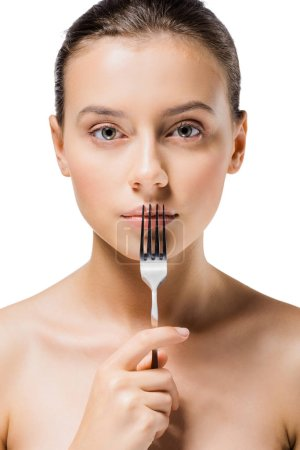 young beautiful woman with silver fork near mouth