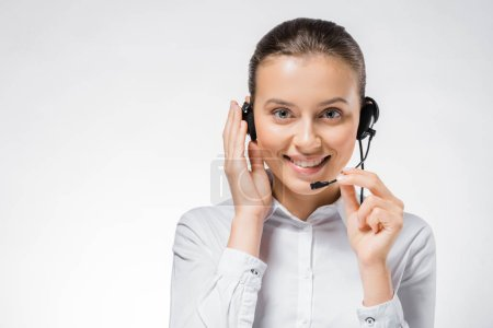 young smiling call center operator working in headset