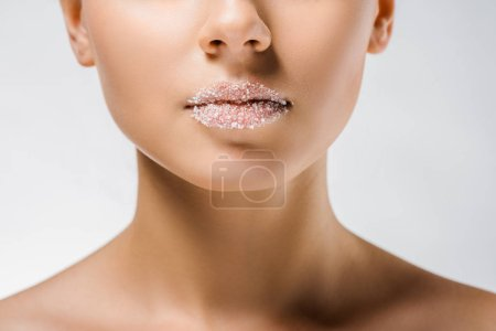 close up of young woman with sugar on lips