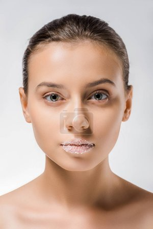 young beautiful woman with sugar on lips