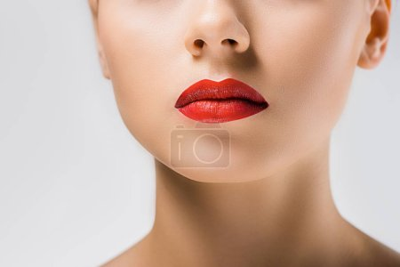 close up of young beautiful woman with red lips