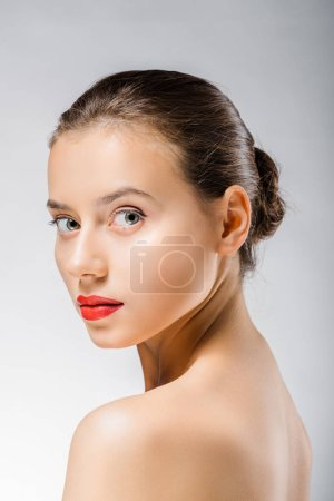 young beautiful woman with red lips looking at camera