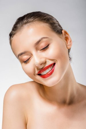 young smiling beautiful woman with red lips and closed eyes