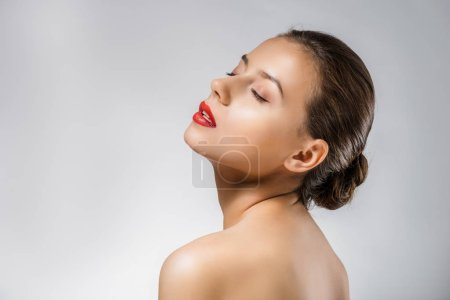 young beautiful woman with red lips and closed eyes