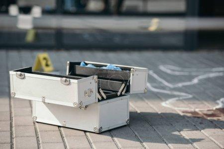 investigation tool box standing open near chalk line