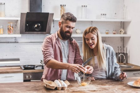Photo for Beautiful smiling couple preparing breakfast together - Royalty Free Image