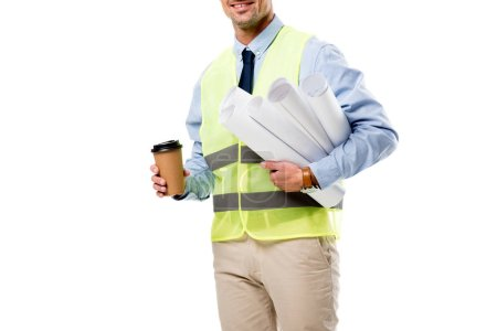 partial view of engineer holding blueprints and coffee to go isolated on white