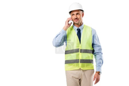 handsome engineer in helmet talking on smartphone isolated on white