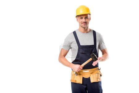 construction worker in helmet looking at camera and holding hammer isolated on white