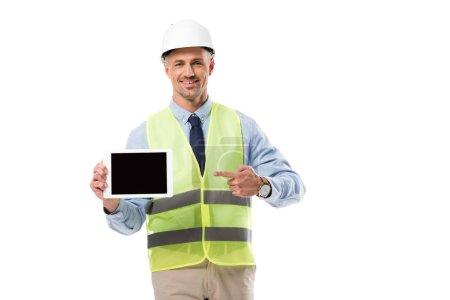 Photo pour Ingénieur souriant pointer avec le doigt à la tablette numérique avec écran blanc isolé sur blanc - image libre de droit