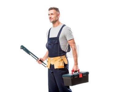 Photo pour Beau travailleur tenant clé à tuyau et boîte à outils isolés sur blanc - image libre de droit