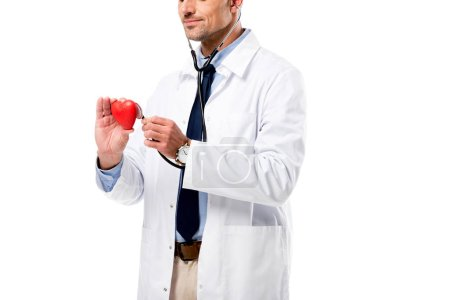 cropped view of doctor examining heart model with stethoscope isolated on white, heart healthcare concept