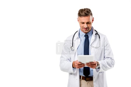 Photo for Doctor in white coat with stethoscope using digital tablet isolated on white - Royalty Free Image