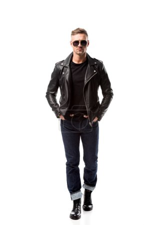 stylish adult man in leather jacket with hands in pockets isolated on white