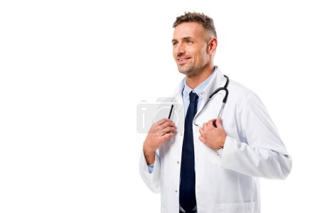 handsome doctor in white coat with stethoscope looking away isolated on white