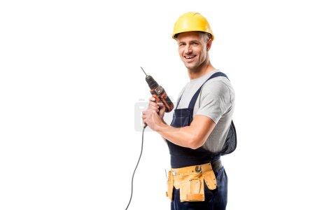 Photo pour Travailleur de la construction souriant dans un casque tenant exercice isolé sur blanc - image libre de droit
