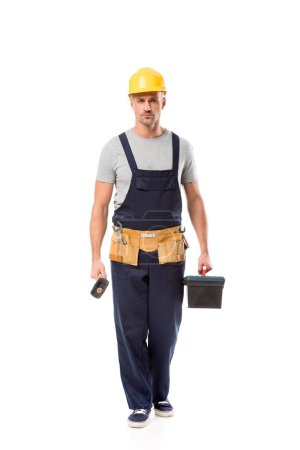 construction worker holding hammer, tool box and looking at camera isolated on white