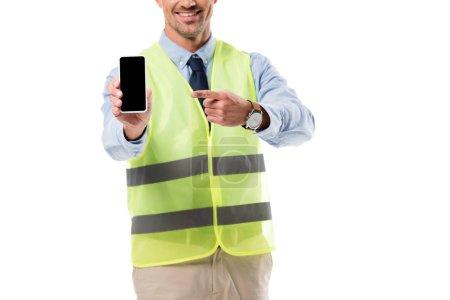 Foto de Vista recortada del ingeniero señalando con el dedo en el smartphone con la pantalla en blanco aislada en blanco - Imagen libre de derechos