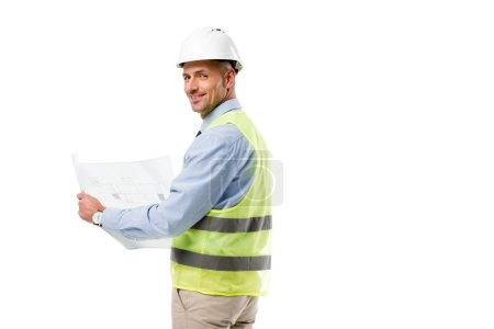 engineer in helmet looking at camera and holding blueprint isolated on white