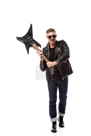 Photo for Excited stylish man in leather jacket holding electric guitar isolated on white - Royalty Free Image